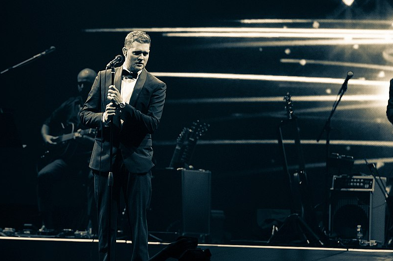 Michael Buble At Key Arena in November 2013. John Lill [CC BY 3.0 (https://creativecommons.org/licenses/by/3.0)], from Wikimedia Commons