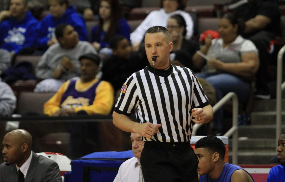 Kevin Lawrence keeps a close eye on the action as a PIAA basketball official.