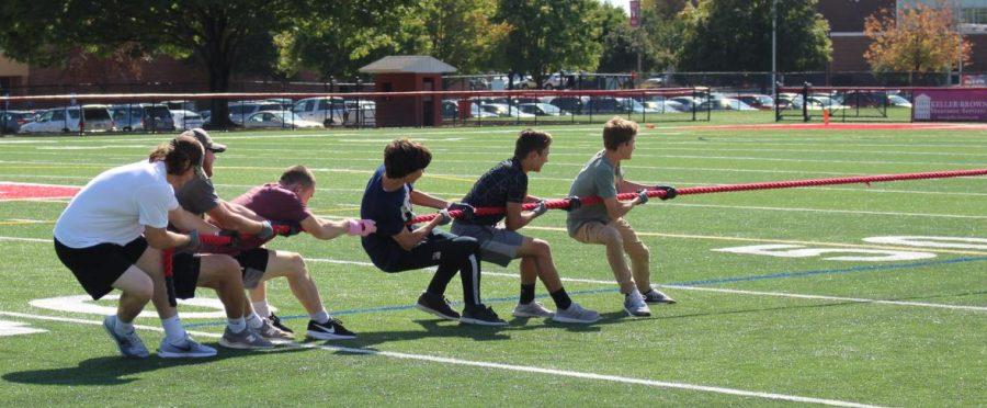 Students challenge one another in a tug-of-war competition. Seniors and sophomores competed against the juniors and freshman. In the end, the seniors and sophomores won.