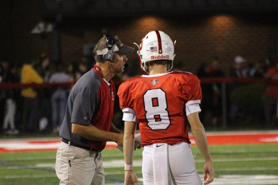 Senior+quarterback+Matt+Allen+talks+to+Coach+Wiles+about+the+next+play.
