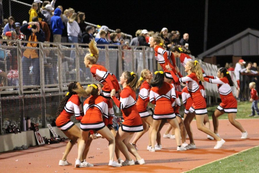 The cheerleaders perform a stunt to cheer on the Warriors.