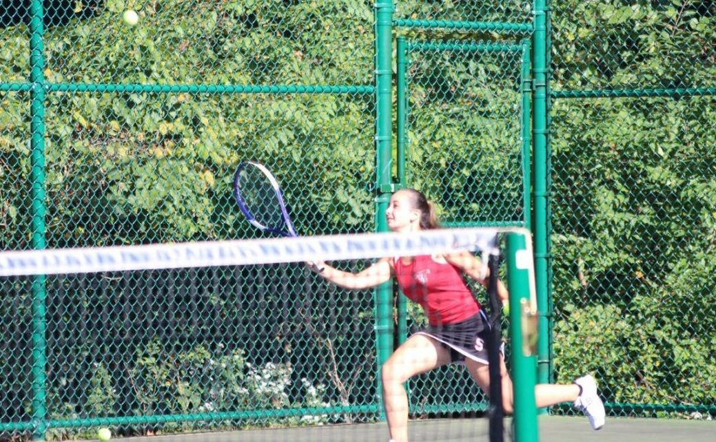 Sophomore Jillian Bolio runs to hit the ball to her opponent.  Photograph by Sam Timlin