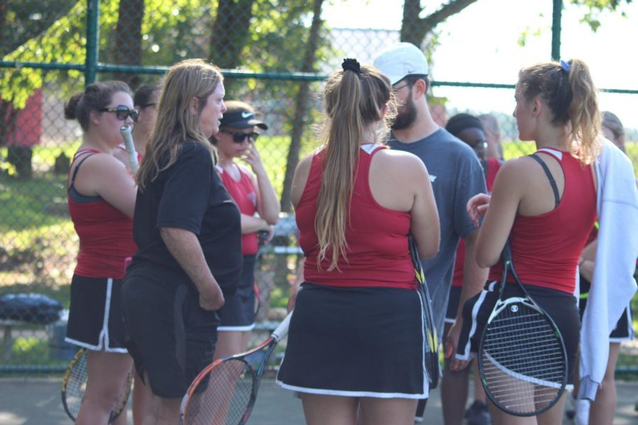 Coach Michels's favorite part about tennis is watching the girls improve.