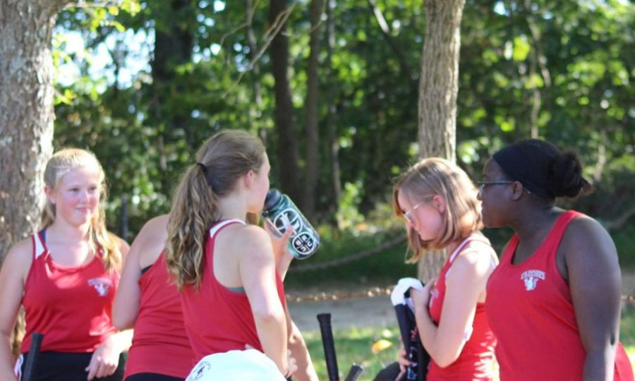 Girls tennis members sophomore Trinity Boone, sophomore Kailey Messersmith, sophomore  Angela Kontz and sophomore Brecken Macdougall take a well earned break from practicing. Photograph by Sam Timlin