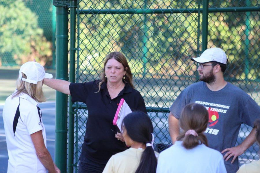 Coach Michels loves tennis.