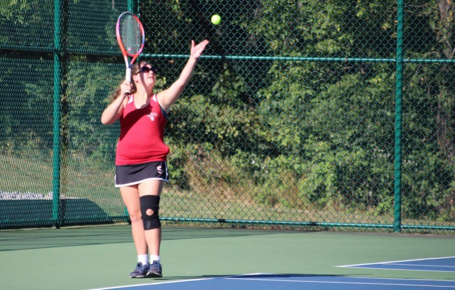 Junior Diana Kelbaugh prepares to hit off a serve to the opposite team.  Photograph by Sam Timlin