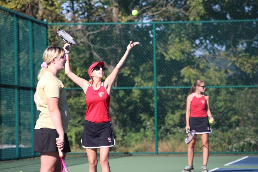 Junior Jessica Hall prepares a serve to the opposite team during a practice. Photograph by Sam Timlin