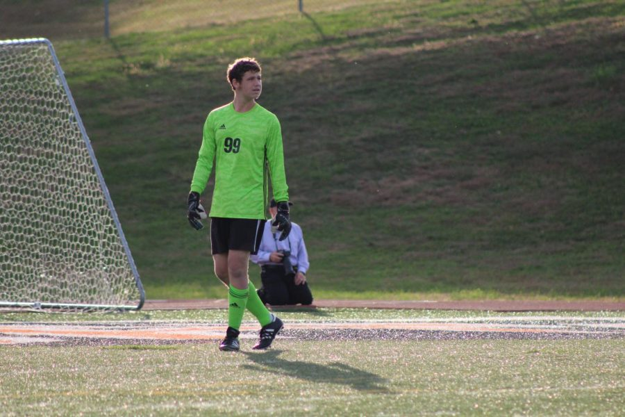 Senior Nick Koval tends the goal preparing to make another stop for the Warriors. The team has accomplished nine one-goal games on defense this season. Photo by Mackenzie Womack.