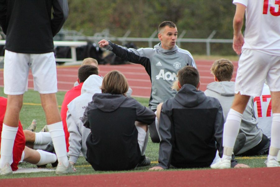 Head coach Brett Maxwell gives is team the talk in order to win this competitive game. At halftime, the score is 0-0.  Photo by Mackenzie Womack.