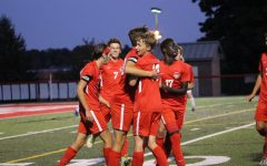 Warriors celebrating after scoring another goal. Photograph by Maggie Grim