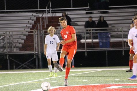 Senior Jonathan Lippy takes a free kick at midfield. Photograph by Maggie Grim