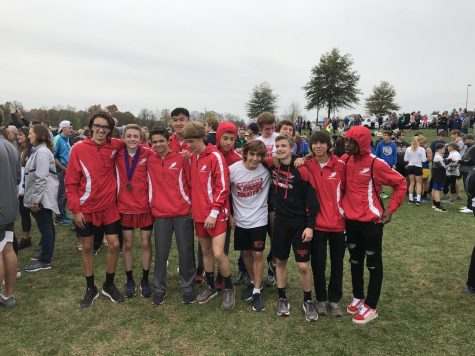 The Warriors boys cross country team smiles after qualifying for the state tournament.  Photograph by Jim Lebo