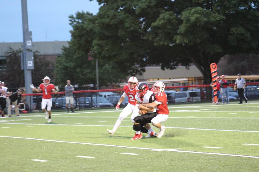 The Defense holds their ground as D. Clapp takes down an Eagles player as they try to make a play.