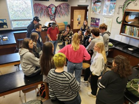 APES students listen to Mr. Brown explain different components of soil. Photograph by Elizabeth Worley