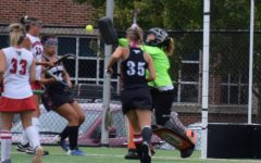 KC making a pad save against the Southwestern Mustangs. Photographed by Liz Dauberman