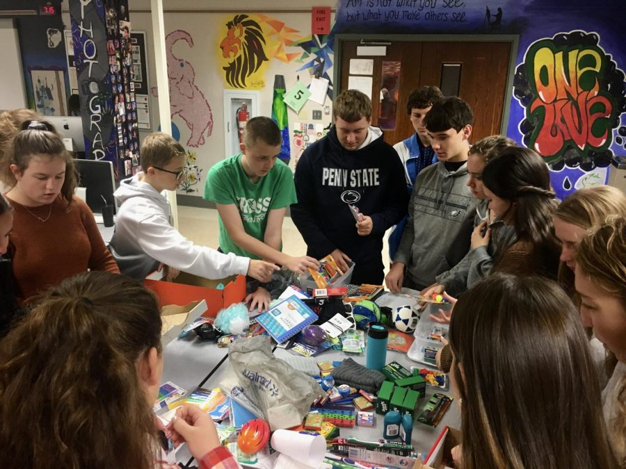 Students assembling boxes for Operation Christmas Child. Photograph by Wade Bowers