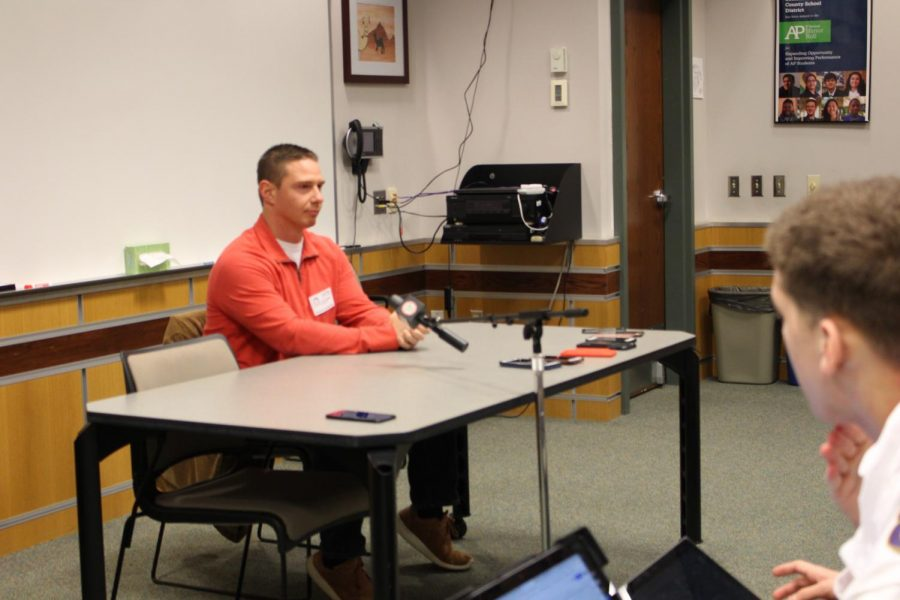 John Buffone listens to students as they ask him questions about his experiences.