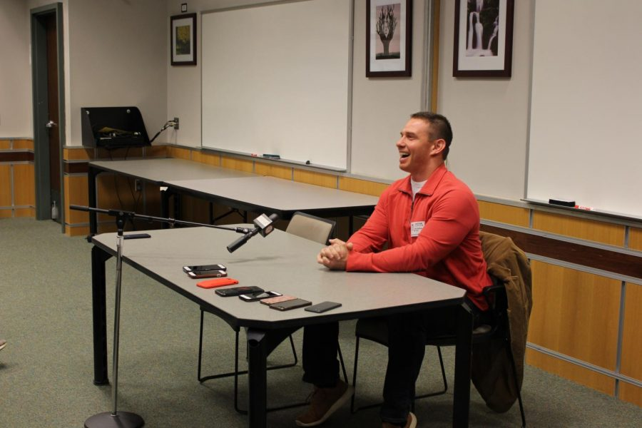 Buffone laughs as he gives an answer to a question asked by one of the students.