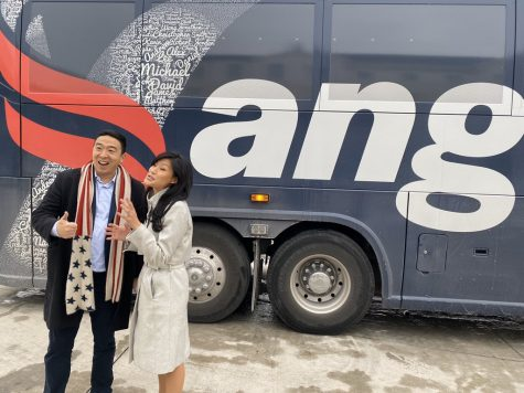 Andrew Yang smiles with his wife in front of the Yang bus. Photograph  @AndrewYang via Twitter