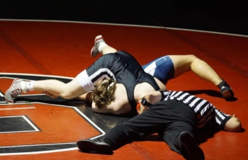 Little Man pins down his opponent during the West York match. Photo via @ohmann_55 on Instagram.