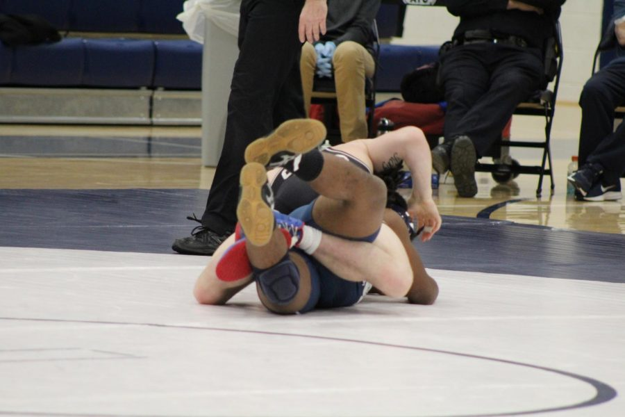 Romjue gains control over the Bulldogs wrestler after accomplishing his first move. Photo by Mackenzie Womack.