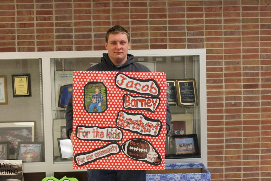 Senior candidate, Jacob Barnhart, stands with his donation box, created by him. Photo by Tricia Rawleigh.