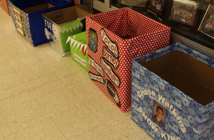 Snow Kings have decorated a box for students to donation canned goods and money. Photo by Mackenzie Womack.