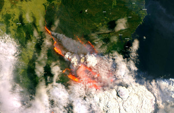 A satellite image of Batemans Bay from December 31, 2019 shows smoke and fire from wild bushfires in New South Wales in southeastern Australia. Image Courtesy of: Copernicus Sentinel Data/Handout via Reuters via cbsnews