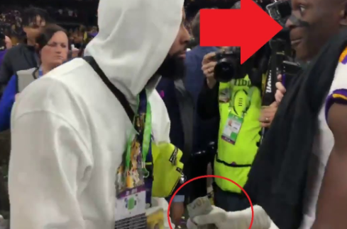 Cleveland Browns' Odell Beckham, Jr. handing out stacks of cash to LSU players after their National Championship win. Photo courtesy @OSUOverload via YouTube.