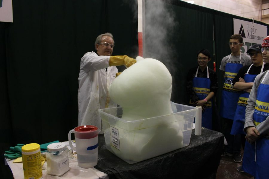 Students+watch+as+this+chemistry+presenter+creates+%27elephant+toothpaste.%27+Vincent+Chen+was+the+most+thrilled+when+the+%E2%80%9CElephant+Toothpaste%E2%80%9D+grow+before+his+eyes.%0APhotograph+by+Ava+Holloway