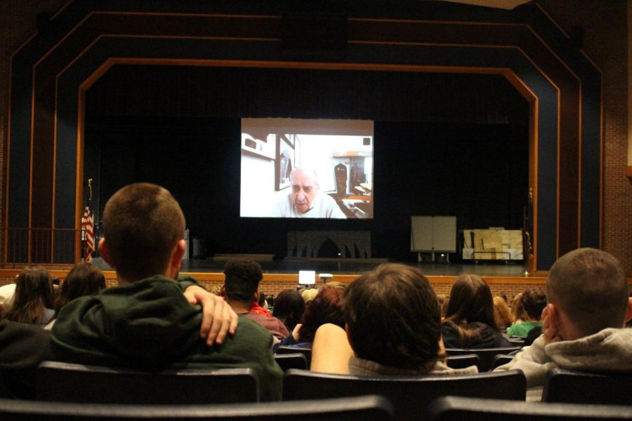 Students sit and listen to David Tuck as he speaks of his time in Auschwitz. Photograph taken by: Maggie Grim