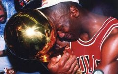 Michael Jordan cherishes the Larry O'Brian Trophy after he won his first NBA Finals in 1991 after beating the Los Angeles Lakers.   Photograph by @paveibure24 via Twitter