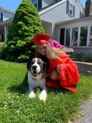 Senior Amber McClure posing for a picture with her dog.