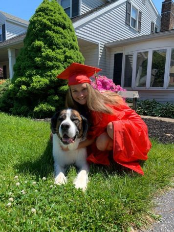 "Senior Amber McClure posing for a picture with her dog. ""I see myself graduated college, pursuing a career in possibly nutrition or animal sciences,"" said McClure. ""I would like to work full time at a temporary job while I am looking for a more permanent job. I would love to get my own place, somewhere in the country, hopefully with my friend or significant other. I would also get a puppy when I graduate so I can have something to come home to."" Photograph courtesy of Amber McClure."