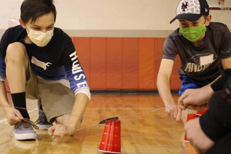 Another teamwork activity was to stack cups with string attached to a rubber band. Photograph by Maggie Grim