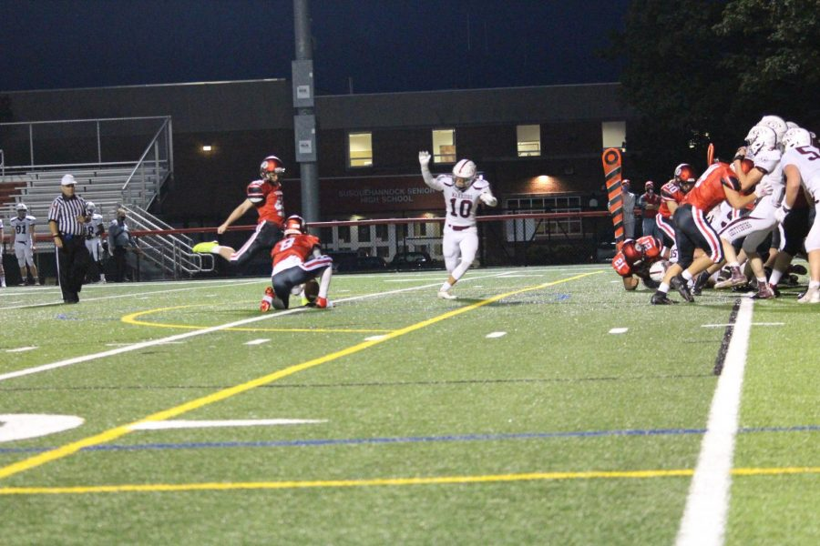 Junior Scott Denis attempts kicks the extra point after Susquehannock's lone touchdown. Photograph by Jacob Stroh