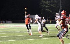Sophomore Brad Bennett attempts a pass over Gettysburg defenders. Bennett finished the game with 7 completions for 100 yards, 1 touchdown and 2 interceptions. Photograph by KC O'Neill