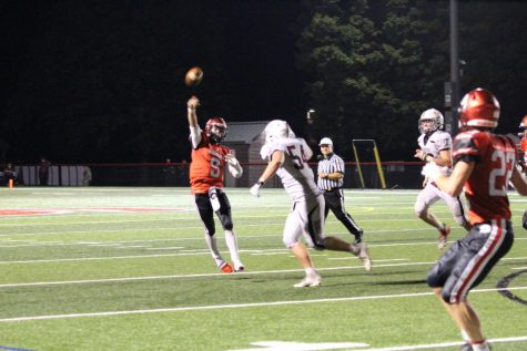 Sophomore Brad Bennett attempts a pass over Gettysburg defenders. Bennett finished the game with 7 completions for 100 yards, 1 touchdown and 2 interceptions. Photograph by KC O