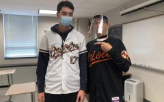 Teacher Matt Amberman and junior Gavin Comber support Orioles Baseball for Jersey Day. The other themed days included pajama day, tacky tourist day and school spirit day. Photograph by Elaine Paulk
