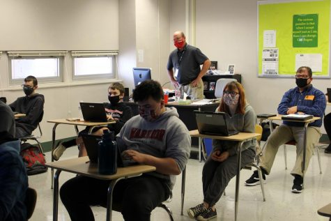 Bill Kerr helps students take notes and answer questions from a movie they watched.  Photography by KC O