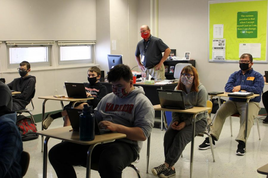 Bill Kerr helps students take notes and answer questions from a movie they watched.  Photography by KC O'Neill