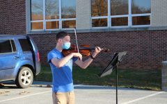 Ian Rosul plays the viola   for Smartmusic outdoors. Photo by Elaine Paulk.