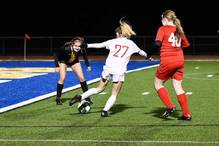 Senior striker Emily Rathell makes a move to surpass a defender at the All-Star girls soccer game. Rathell scored a total of 12 goals throughout the season, as well as, making 10 assists. She had an additional goal at the All-Star game.