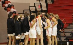 Team gathers to start the game. Photograph by Lola Sroka.