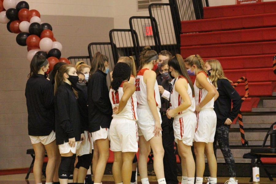 Team gathers to start the game. Photograph by Lola Sroka.