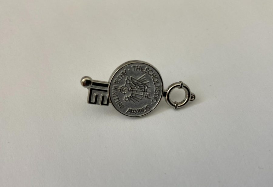 Scholastic competitors who won silver or gold keys receive pins. Photograph by Tim  Groth