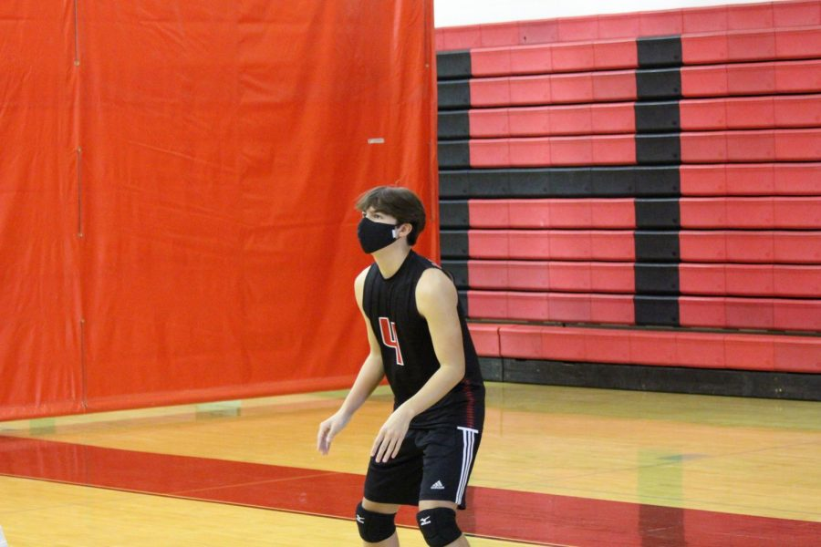 Sophomore Matthew Snyder is ready to receive a serve during volleyball practice.