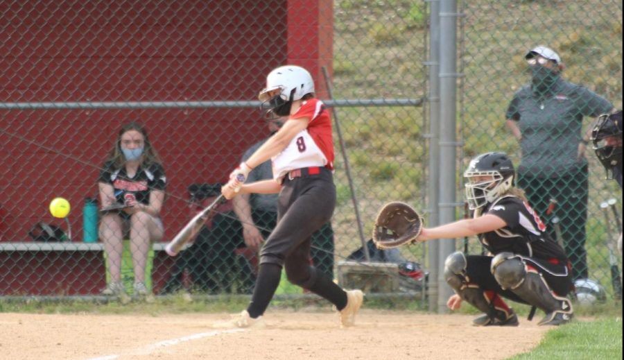 Sophomore Jocelyn Davis strikes the ball as the Warriors continue trying to put runs on the board. Photograph by Evelyn Weldon