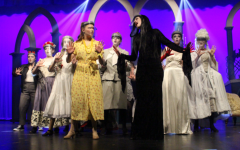"""Morticia Addams, portrayed by Greta Hartman, Alice Beinek, portrayed by Juliana Quintillian, and the female ancestors dance together in """"Secrets"""". A cast favorite, this number features a creative, conversation-like song and dance that keeps the audience engaged and interested in the show. """"I am constantly in awe of the talent and creativity of the production team, and that is the reason why I plead with them to come back year after year,"""" said Jenkins. """"They are so great at taking my outlandish ideas and making them concrete -- and in many ways making them better than I ever imagined."""" Photograph by Grace Hartenstein"""