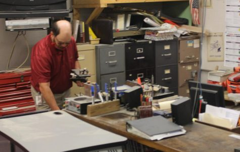 Stoneberg finishes up work as he finishes his last day of school with students. Photograph by Maggie Grim